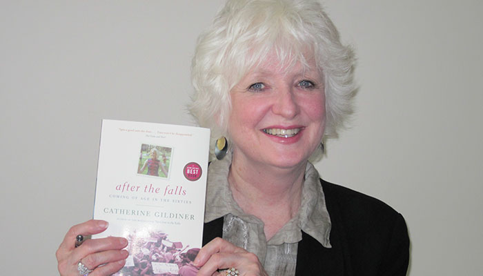 Catherine Gildiner holding a copy of After the Falls
